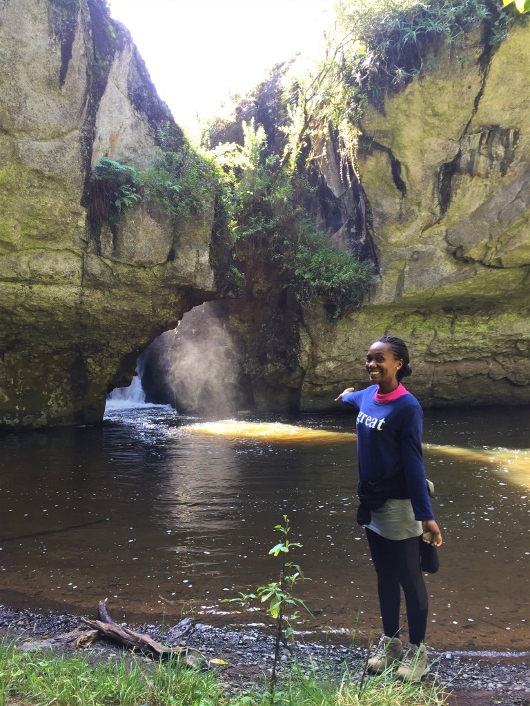 Nelly standing at a section of the Mau Mau Cave in Nayuki, Kenya.