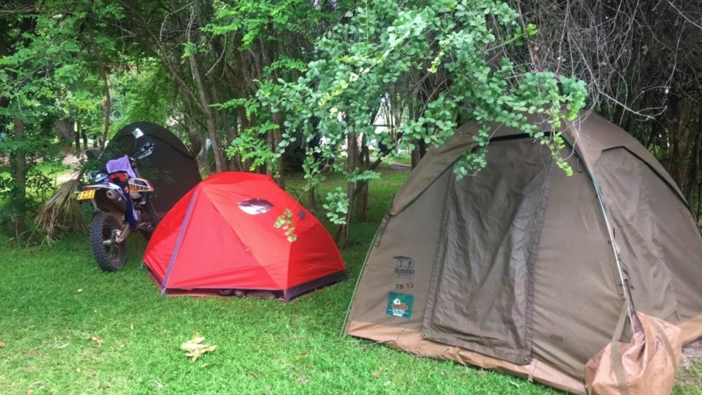 Three tents set up in Victoria Falls Waterfront campground in Zambia.